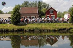 The pack of riders cycles in the city of Abbeville during the fourth stage of the 99th Tour de France cycling race between Abbeville and Rouen. STEPHANE MAHE/REUTERS