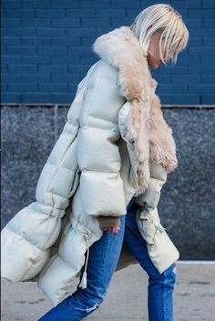 Loving this off-white puffer jacket paired with jeans! Click to see our top picks to keep you warm this winter..