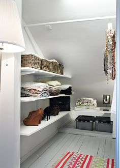 Deep, sloped, closet organization