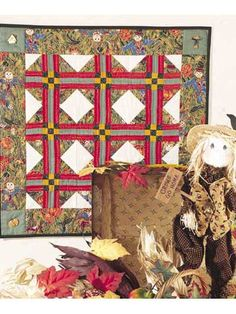 """Halloween Harvest Choose fall prints or fall-colored fabrics to make this free wall quilt pattern. Quilt size is 24"""" x 24"""". Block size is 6"""" x 6"""". Designed by Michele Crawford for Coats and Clark"""