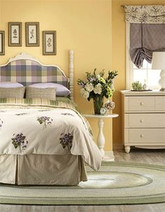 ivory white bedding set with purple flowers, light yellow paint for bedroom walls