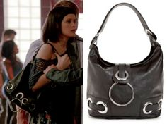 "Sofia (Brina Palencia) wears a Big Buddha Jessie Ring Bucket Bag in the color Black in Star-crossed Season 1 Episode 1 ""Pilot."""