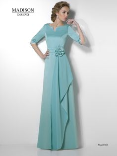 Long turquoise dress with a flower on waist Mother Of Groom Dresses, Mothers Dresses, Bridesmaid Dresses, Prom Dresses, Formal Dresses, Wedding Dresses, Vestidos Marisa, Mom Dress, Quinceanera Dresses