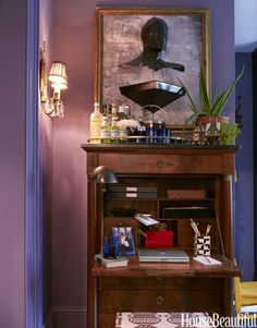 Tight Space In this small East Village apartment, designer David Kaihoi used flexible pieces of furniture, like this antique gentleman's chest. It serves as a desk, a bar, and even as baby changing station.   Read more: http://www.housebeautiful.com/decorating/office-decorating-ideas#ixzz2jeCjymDa