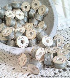 Spools of silver thread
