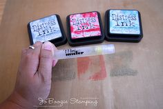 Creating your own background with Distress Inks, water, and a stamp.