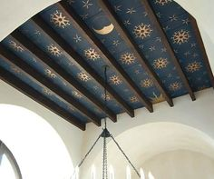This would be a great way to cover up ugly ceiling tiles! If you put in fake beams and paint the tiles like this!!