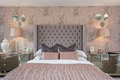 The master bedroom has an impeccable floral wall and gorgeous lush interior design and not to mention the wonderful colour scheme.