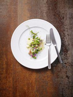 Morten Falk. Kay Bojesen dinner knife and dinner fork. Photo: Henrik Freek Christensen. Kay Bojesen Grand Prix cutlery. Danish Design.