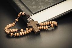Picture of christian cross necklace on holy bible book jesus religion concept as good friday or easter festival.