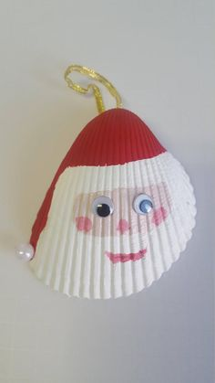 All Santa shell ornaments are one of a kind and may differ a little in size and design. Christmas Crafts For Kids, Christmas Decorations To Make, How To Make Ornaments, Holiday Crafts, Seashell Christmas Ornaments, Shell Ornaments, Seashell Painting, Painted Shells, Seashell Crafts