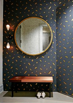 In Brooklyn's Dumbo neighborhood, the home of a family of four was renovated by Rachel Kane and Xandro Aventajado of the New York–based firm Current Interiors. Apparatus Studio's brass Dyad sconce lights the entryway, which is lined with Juju Papers's Pas de Trois wallpaper.