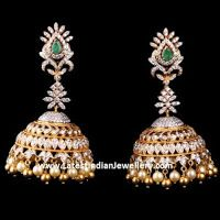 Scintillating pair of Diamond Jhumkas in a traditional design that are hard to take your eyes off. Diamond buttalu with emeralds and pearl and gold ball drops Long Diamond Earrings, Diamond Jhumkas, Pearl And Diamond Necklace, Diamond Earing, Gold Hoop Earrings, Diamond Studs, Diamond Jewelry, Gold Jewelry, Pearl Necklaces