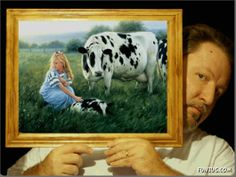 Robert Duncan holding one of his paintings