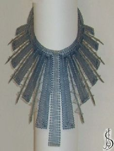 Necklace No. 10845  		   Dark blue silk and silver. Price: € 118 Other color variations are in the catalog.  ............................  P...