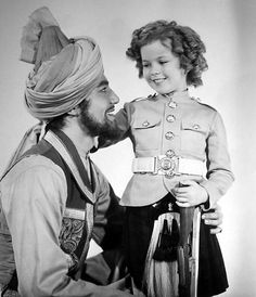 B'day celebrant Cesar Romero with Shirley Temple in a publicity photo for Wee Willie Winkie (1937) -- Romero played Koda Khan in this beloved film.