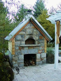 """I like it!: She says, """"My husband built this pizza oven at our old house in CT.  I miss it!"""""""