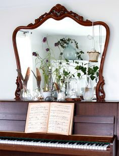 ornate wooden mirror and piano / sfgirlbybay