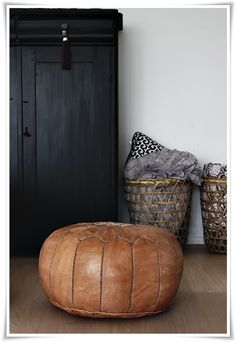Tan leather pouffe available at crystalcovecollective.com.au