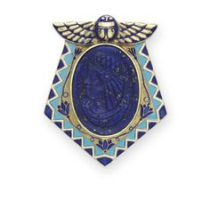 An Egyptian - revival  brooch.  Bezel-set with an oval lapis lazuli cameo of a Egyptian man in profile, within a textured gold, turquoise, blue and white enamel shield-shaped plaque, surmounted by a gold and blue enamel scarab, mounted in gold, circa 1925,