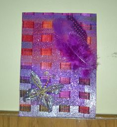 Silk Fabric background with butterfly on bottom corner and plum feathers at top; www.facebook.com/uniquelyvalentine