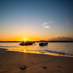 Sunrise at #gilitrawangan harbour with mount rinjani view.. #sunrise #beach #boats #raysoflight #reflection #instanusantara #indonesia_photography #special_shots #sengajaphoto #backpacker_photography  #ig_indonesia_  #igworldclub #gf_indonesia #instagallery_ina  #supersunset #cool_sunshotz #shotaward #phototag_it #allshots_ #hot_shotz  #sunset_madness  #insta_crew #ic_landscapes #fotonesia #tgif_sunset