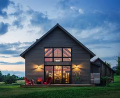 This modern barn house was designed by Joan Heaton Architects, along with builder Silver Maple Construction, located in Weybridge, Vermont.