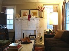 beautiful mantel arrangement and warm, calm colors on walls/furniture. love this.