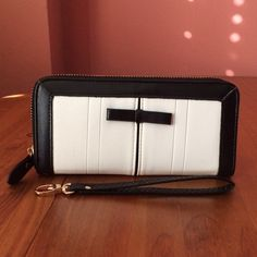 """Vegan Leather Tuxedo Clutch NWOT Chic and modern black & white zippered clutch. Interior zipper pocket, multiple card & ID slots, open area for bills, wrist strap. Fits easily in to purse or can be carried on its own. Approximately 7.5""""L v 4.5""""H. Please ask if you have questions. Bags Clutches & Wristlets"""