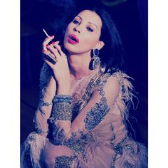 Ingrid Vlasov,smoking,feather and stones dreass,tulle,fashion,earrings
