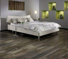 Dark grey laminate flooring in bedroom with white bedding sets