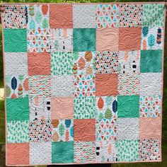 Peach and Green Tribal Baby Quilt from http://www.HomeSEwnByCarolyn.com