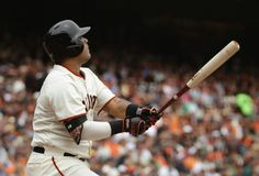 San Francisco Giants' Hector Sanchez hits a sacrifice fly off San Diego Padres starting pitcher Ian Kennedy during the second inning of their baseball game Wednesday, June 25, 2014, in San Francisco. The Giants' Brandon Crawford scored from third on the play. (AP Photo/Eric Risberg)