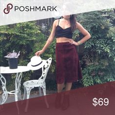 """Vintage Suede Midi Skirt High waisted midi skirt in a really good quality suede. The semi A-line cut is bohemian and retro. If you think you can't wear crop tops, now is the time, because it will flatter you shape when paired with this gem! Dark maroon vampy color. Fully lines. Side zip and clip closure. Length = 26"""". Waist = 28"""". Vintage Skirts Midi"""