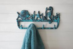 Items similar to Cast Iron Coral Reef Wall Hook - Fish, Coral, Sea Horse, and Starfish - Jewelry Holder - Key Hook - Towel Hook on Etsy Towel Holder Bathroom, Towel Hooks, Key Hooks, Wall Hooks, Cast Iron, It Cast, Wooden Hangers, Kitchen Themes, Blue Walls