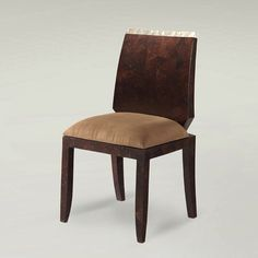 An elegant chair, made of a polished coconut shell with a light accent of a white seashell, a piece of a Jewel dining room collection by Dsign.