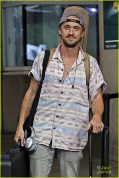 Oh you gorgeous man JustJaredJR Tom Felton arrives back at the airport with all his instruments over the weekend in Vancouver, Canada.