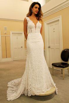 Season 14 Featured Dress: Lazaro. Plunging neckline, ruching, textured, feathered bottom. $6,800.