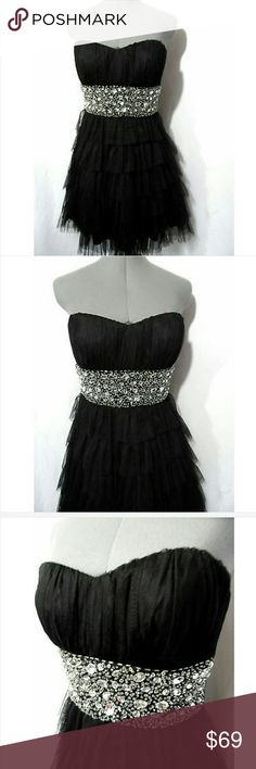 "DEB Formal Prom Dress 9/10 Black Beaded TULLE Tier Individual monitors may display slightly different color or hues...??  DEB Formal Dress  TAG SIZE: 9-10 BUST: 32-36"" (very slight give in fabric) WAIST: 29-32"" LENGTH: 29"" from top of the shoulder down? Quality construction Sweetheart neck Rhinestone bead encrusted, empire waist Tiered tulle layers Tie back Knee length (depending upon your height)Boning and slight stretch for great fit!Thick fabric, no bra necessary! Black in color Worn…"