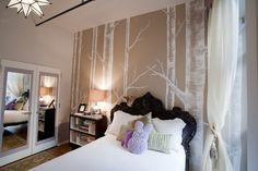Tree mural behind the bed