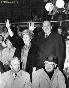 Walt Disney and his wife Lillian watching the Christmas parade at Disneyland.