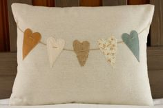 Decorative Valentine's Day Heart Pennant Pillow Cover - Soft, Shabby Chic Colored Hearts on Osnaburg Pillow - 12 x 16. $23.00, via Etsy.