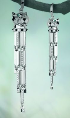 Panthére Earrings, white gold, diamonds, onyx, emeralds.