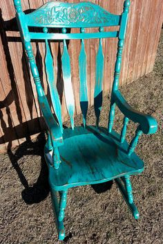 Turquoise rocking chair that I restored very cool.