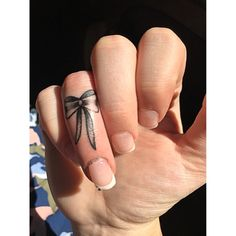 Small bow tattoo on finger #tattoo #small #girly #black #shaded #unique #mine
