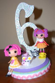 our lalaloopsy cake topper, so easy to make and we were able to take off after so she could keep them to play with!