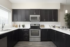 Spacious u-shaped kitchen with peninsula island and stainless steel appliances #kitchen