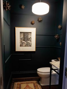 Powder Room 💕💕 black or navy moulded walls, iron stand with marble top vanity.