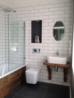 White brick tiles with dark grey grout. Scaffold plank bath panel and sink unit. Brick Tiles Bathroom, Bathroom Sink Design, Small Bathroom Sinks, Bathroom Interior, Bathroom Ideas, Grey Grout Bathroom, Master Bathroom, Brick Tile Wall, Industrial Bathroom Vanity