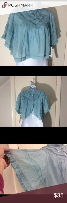 """Free People Top NWT Free People light blue cropped top. Lace detailing on chest. The back has an open lower back, unique style. 18"""" from shoulder to hem. Width is 21"""" pit to pit. Free People Tops"""